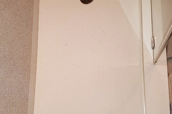 "Mystery ""Stain"" On CaesarStone Shower"